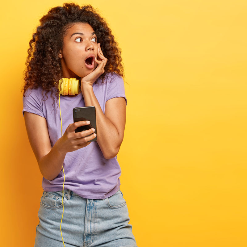 Surprised young woman looking excitedly off-screen